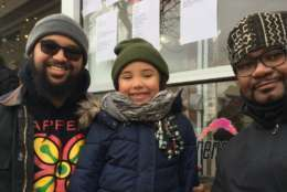"""Mike Bolds, Ife Bolds Jacob, Emile Smith at the MLKPeace Walk and Parade. Ife Jacob, 5, said, """"His dream was that everybody was treated fairly and that segregation would stop and that people wouldn't be hurt by the color of their skin."""" (WTOP/Kristi King)"""