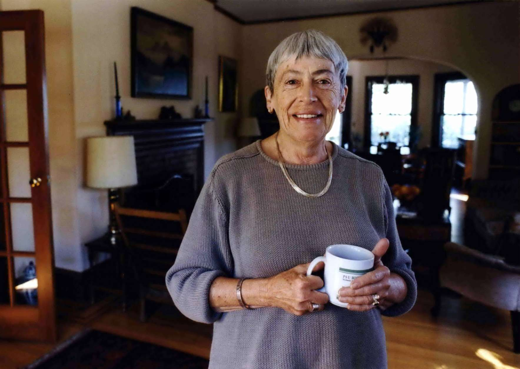 Ursula Le Guin American author of novels, children's books, is seen in a Sept. 9, 2001 photo at home in Portland, Ore. Le Guin, the award-winning science fiction and fantasy writer who explored feminist themes and was best known for her Earthsea books, died peacefully Monday, Jan. 22, 2018, in Portland, Oregon, according to a brief family statement posted to her verified Twitter account. She was 88. (Benjamin Brink/The Oregonian via AP)