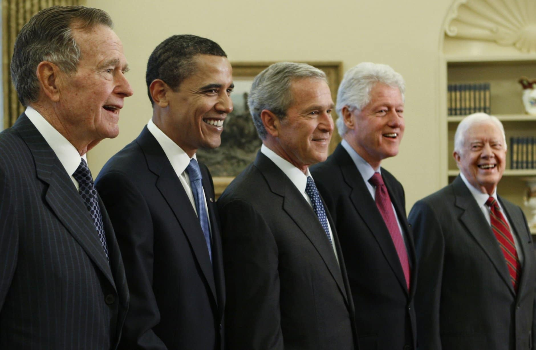 President George W. Bush, center, poses with President-elect Barack Obama, and former presidents, from left, George H.W. Bush, left, Bill Clinton and Jimmy Carter, right, Wednesday, Jan. 7, 2009, in the Oval Office of the White House in Washington. (AP Photo/J. Scott Applewhite)