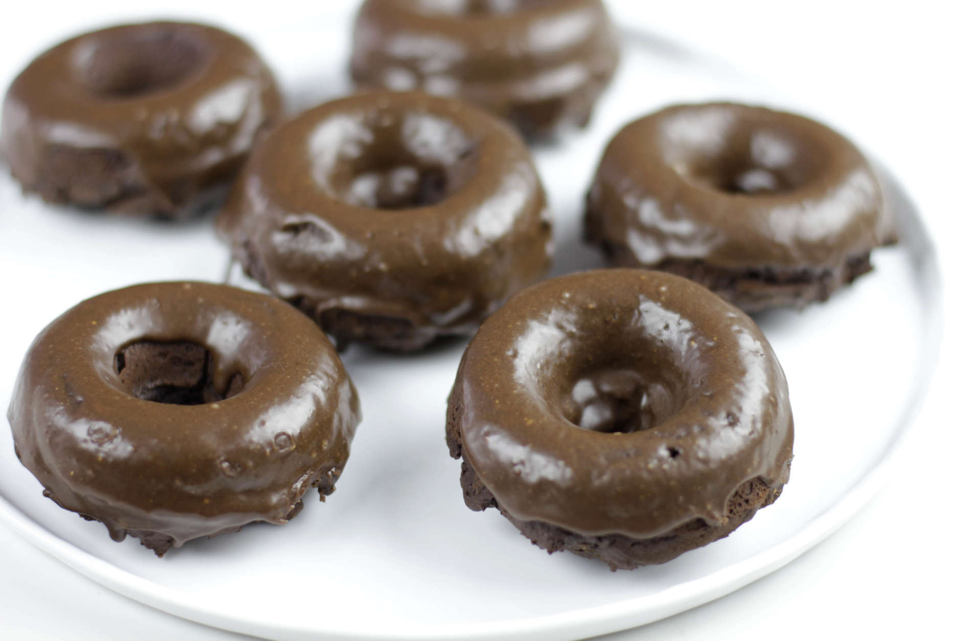This July 12, 2016 photo shows chocolate peanut butter baked doughnuts in Coronado, Calif. This dish is from a recipe by Melissa d'Arabian. (Melissa d'Arabian via AP)