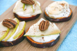 This Nov. 22, 2016 photo shows a recipe for sweet potato toasts made with slices of sweet potato, covered with pear and yogurt and topped with a pecan in Coronado, Calif. ( Melissa d'Arabian via AP)