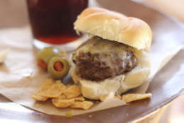 FILE-This Nov. 16, 2015 photo shows beer steamed cheese and mushroom beef sliders in Concord, N.H. This dish is from a recipe by Sara Moulton. (AP Photo/Matthew Mead)
