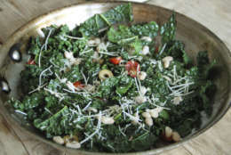 This Jan. 19, 2017 photo shows Tuscan kale sautéed with anchovies, olives, tomatoes and white beans in Coronado, Calif. This dish is from a recipe by Melissa d'Arabian. (Melissa d'Arabian via AP)