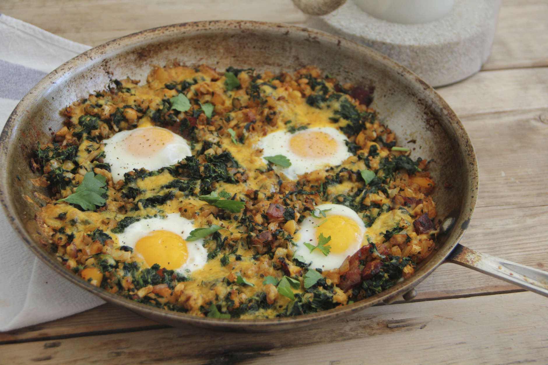 This March 6, 2017 photo shows a country-style breakfast skillet with eggs, bacon and vegetables in Coronado, Calif. This dish is from a recipe by Melissa d'Arabian. (Melissa d'Arabian via AP)