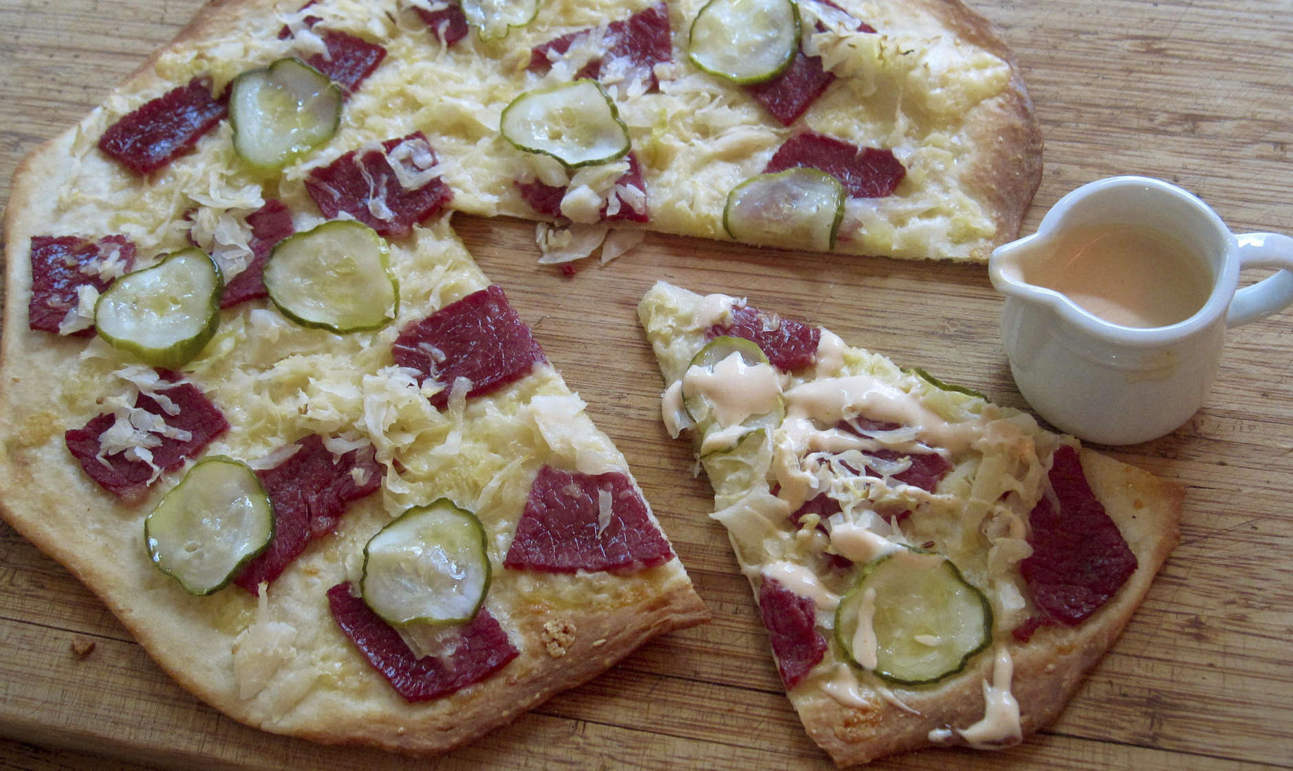 This April 2017 photo shows a Reuben pizza in New York. This dish is from a recipe by Sara Moulton. (Sara Moulton via AP)