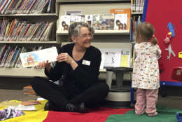 In this April 7, 2017, photo, children's librarian Chere Brown reads to toddlers during a story time at the main Josephine County library branch in Grants Pass, Ore. The library system in Josephine County has been operating as a nonprofit on donations and volunteer hours since it lost public funding, but a measure on the May 16, 2017, ballot could restore limited tax dollars by creating a special library tax district. (AP Photo/Gillian Flaccus)