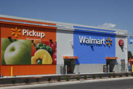 This Tuesday, May 30, 2017, photo shows a 24-hour grocery pickup location at a Walmart in Oklahoma City. Amazon's planned $13.7 billion acquisition of Whole Foods signals a massive bet that people will opt more for the convenience of online orders and delivery or in-store pickup, putting even more pressure on the already highly competitive industry. Walmart, Kroger and others were already stepping up their efforts in delivery and in-store pickup of online orders. (AP Photo/Sue Ogrocki)