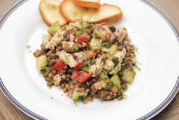 This June 24, 2017 photo shows a lentil and salmon salad with smoky mustard dressing in Coronado, Calif. This dish is from a recipe by Melissa d'Arabian. (Melissa d'Arabian via AP)