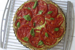 This July 26, 2017 photo shows a tomato, mozzarella and basil tart in New York. This dish is from a recipe by Sara Moulton. (Sara Moulton via AP)