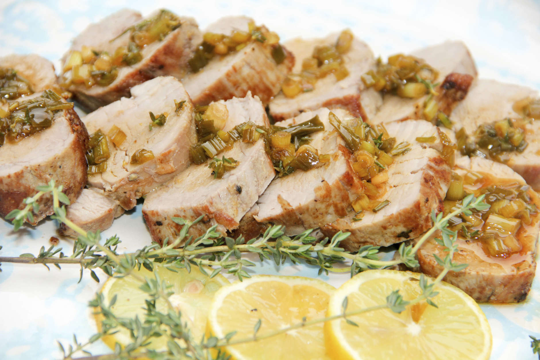 This Aug. 28, 2017 photo shows pork medallions with lemon thyme sauce in Bethesda, Md. This dish is from a recipe by Melissa d'Arabian. (Melissa d'Arabian via AP)