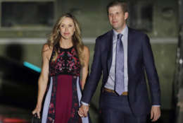 In this Aug, 3, 2017 photo, Eric Trump, right, and his wife Lara Trump, walk away from Marine One on the South Lawn of the White House in Washington.  President Donald Trump has become a grandfather for the ninth time. Eric Trump, the president's son, and Eric's wife Lara welcomed their son on Tuesday.  (AP Photo/Alex Brandon)