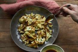 This Jan. 27, 2017 photo shows roasted cauliflower with a sesame drizzle in New York. This dish is from a recipe by Katie Workman. (Mia via AP)