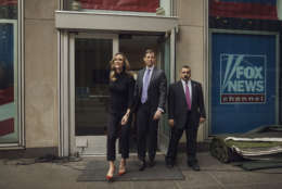 """Eric Trump, left, and Lara Trump, center, leave the Fox Studios after they appeared to tape a segment of """"Justice With Judge Jeanine,"""" in New York, Friday, Oct. 13, 2017. The interview is scheduled to air on Saturday, Oct. 14., on the Fox News Network. (AP Photo/Andres Kudacki)"""