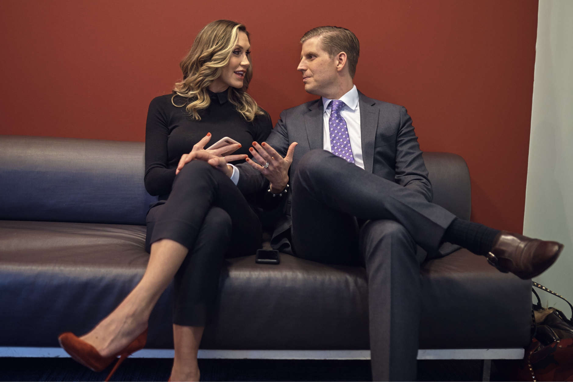 """Eric Trump, right, and Lara Trump, left, wait to tape a segment of """"Justice With Judge Jeanine,"""" at the Fox Studios in New York, Friday, October 13, 2017. The interview is scheduled to air on Saturday, Oct. 14., on the Fox News Network. (AP Photo/Andres Kudacki)"""
