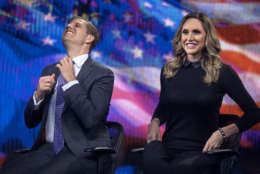 """Eric Trump, left, fixes his tie as Lara Trump, right, smiles while they tape a segment of """"Justice With Judge Jeanine,"""" at the Fox Studios in New York, Friday, October 13, 2017. The interview is scheduled to air on Saturday, Oct. 14., on the Fox News Network. (AP Photo/Andres Kudacki)"""