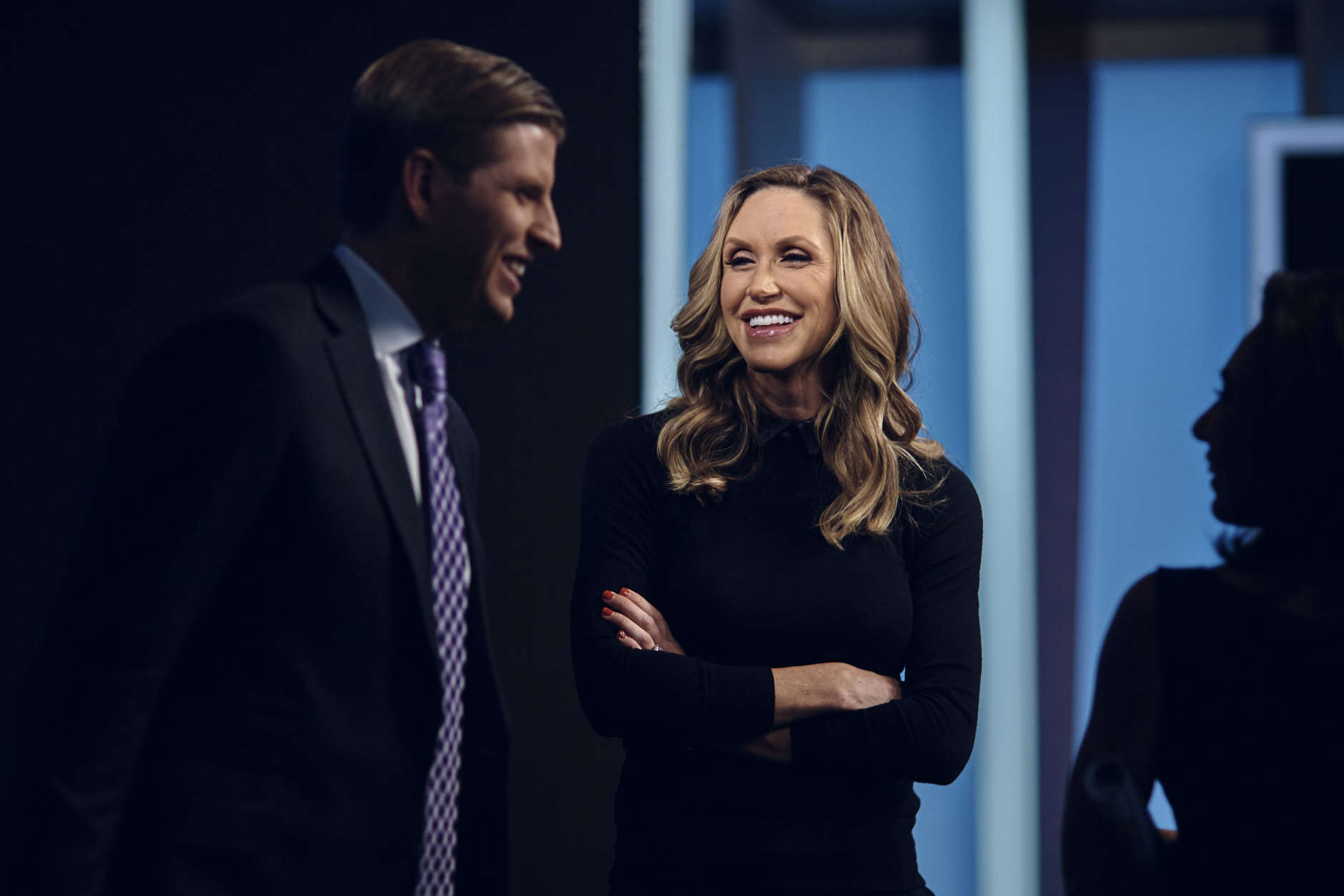 """Eric Trump, left, and Lara Trump, center, talk to Jeanine Pirro, right, after they taped a segment of """"Justice With Judge Jeanine,"""" in New York, Friday, Oct. 13, 2017. The interview is scheduled to air on Saturday, Oct. 14., on the Fox News Network. (AP Photo/Andres Kudacki)"""
