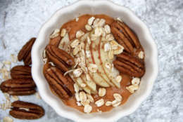 This Oct. 23, 2017 photo shows a pumpkin and spice breakfast bowl in Bethesda, Md. Loading up the freezer with these bowls is an excellent plan-ahead strategy, whether you're a mom of four, or you just want to streamline your mornings. (Melissa D'Arabian via AP)