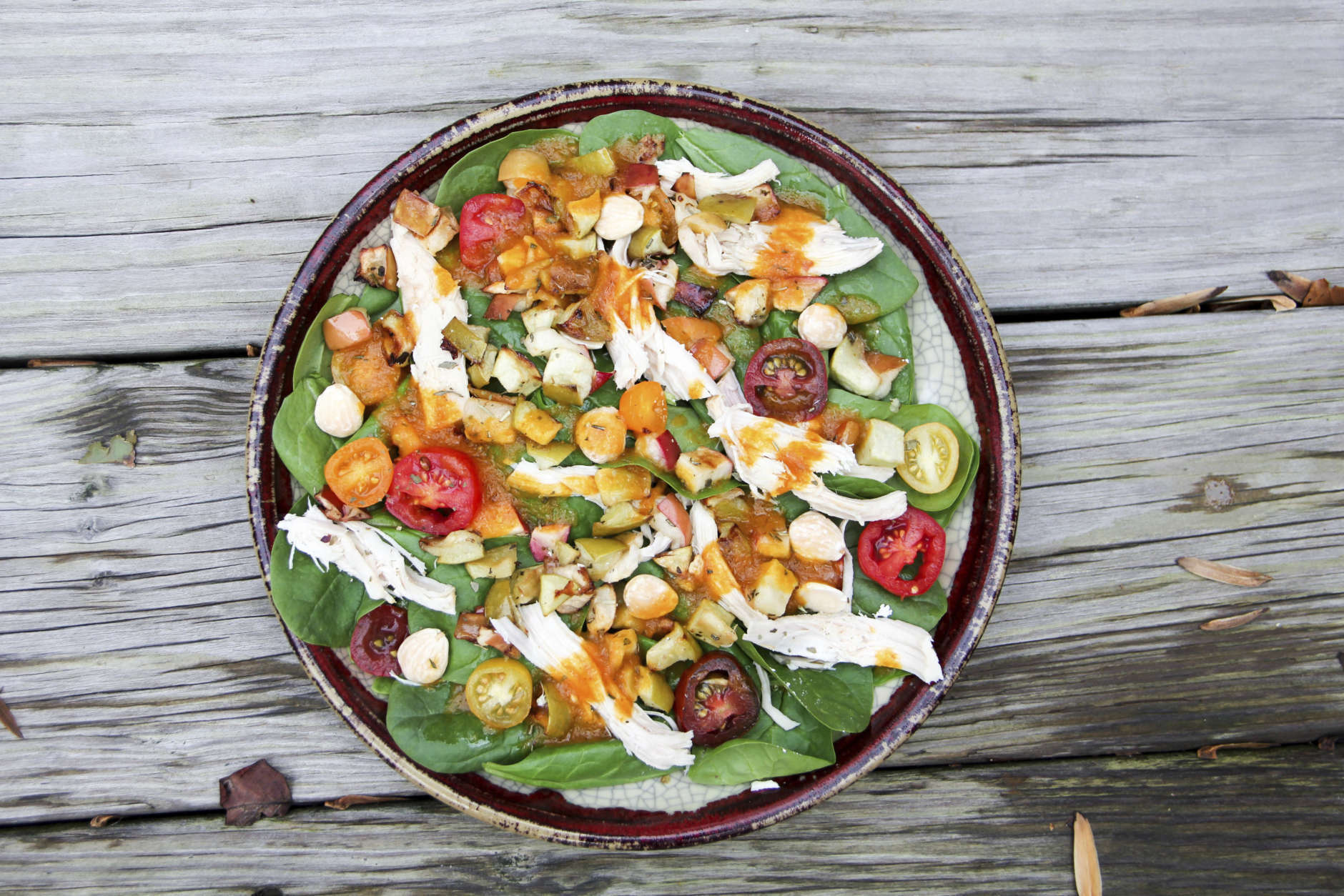 This Nov. 6, 2017 photo shows a green salad with roasted apple and pumpkin vinaigrette in Bethesda, Md. This dish is from a recipe by Melissa d'Arabian. (Melissa d'Arabian via AP)