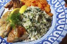 This photo shows a Greek-style rice pilaf served with chicken in New York. This dish is from a recipe by Sara Moulton. (Sara Moulton via AP)