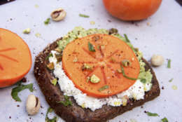 This Nov. 13, 2017 photo shows avocado and goat cheese toast with persimmon in Bethesda, Md. (Melissa d'Arabian via AP)