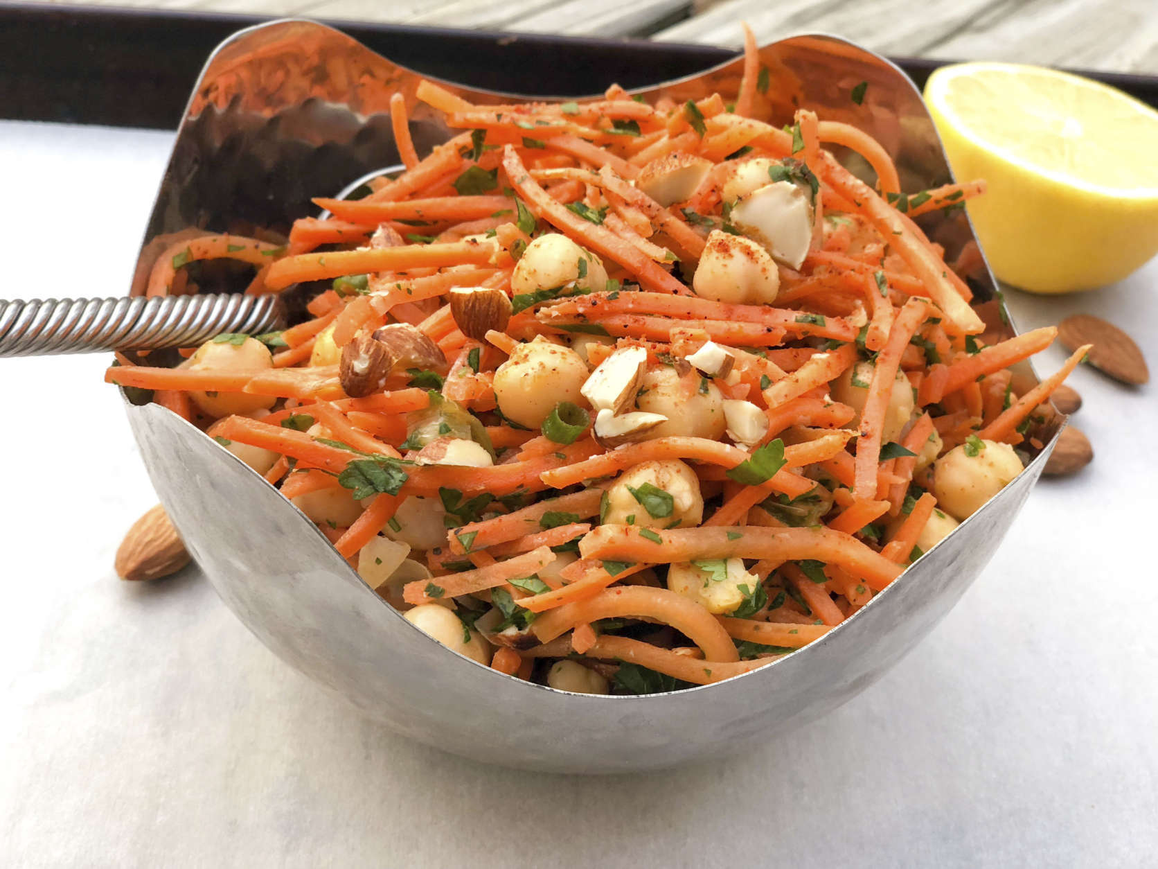 This Dec. 11, 2017 photo shows a North African carrot and chickpea salad in Bethesda, Md. This dish is from a recipe by Melissa d'Arabian. (Melissa d'Arabian via AP)