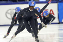 Maame Biney, center, races to finish during the women's 500-meter final A during the U.S. Olympic short track speedskating trials Saturday, Dec. 16, 2017, in Kearns, Utah. (AP Photo/Rick Bowmer)