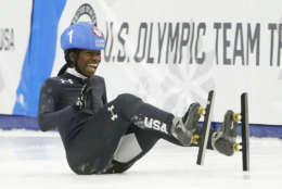 Maame Biney (1) falls as she reacts after winning women's 500-meter A final race during the U.S. Olympic short track speedskating trials Saturday, Dec. 16, 2017, in Kearns, Utah. (AP Photo/Rick Bowmer)