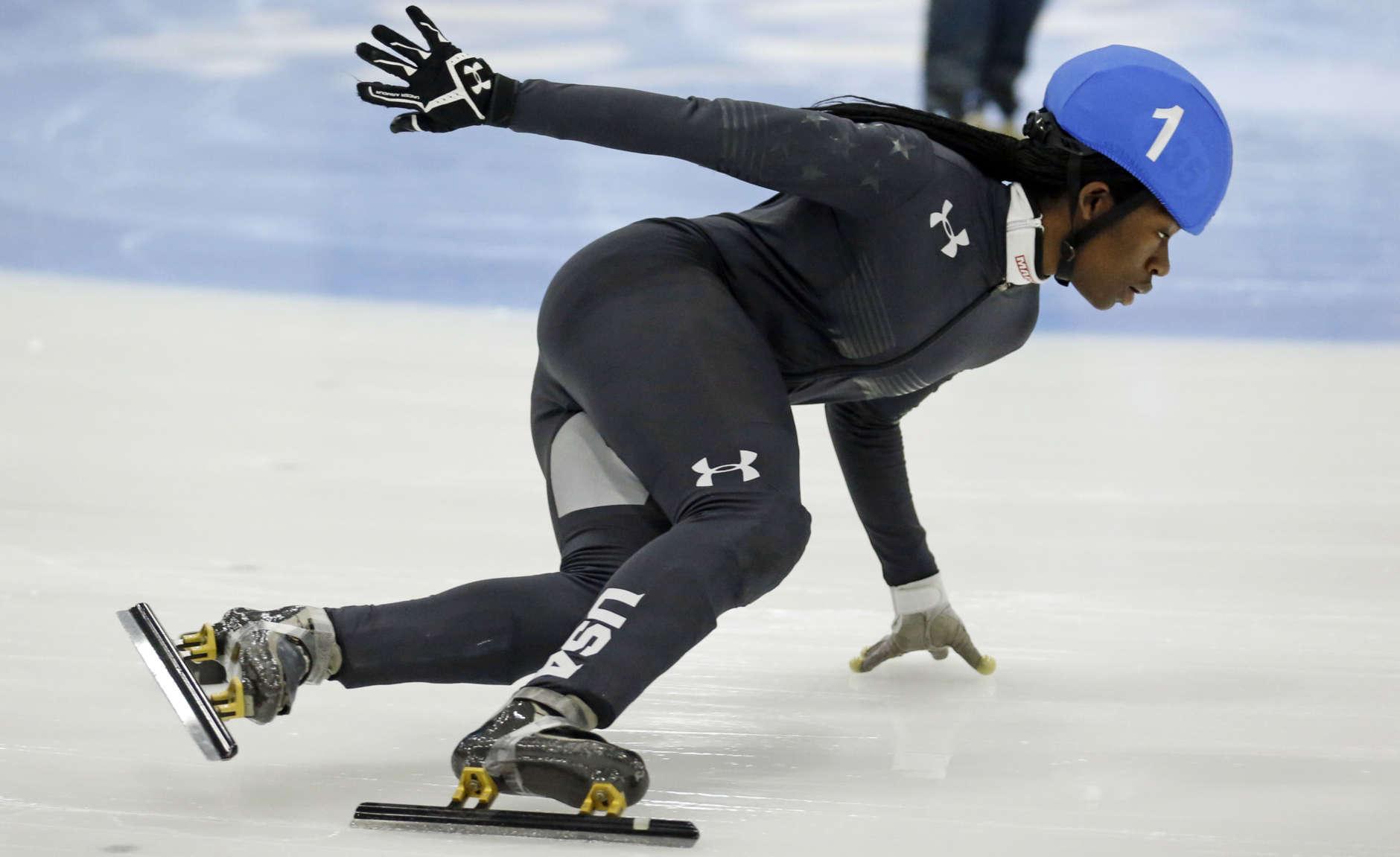 Maame Biney (1) competes in the women's 500-meter A final race during the U.S. Olympic short track speedskating trials Saturday, Dec. 16, 2017, in Kearns, Utah. (AP Photo/Rick Bowmer)