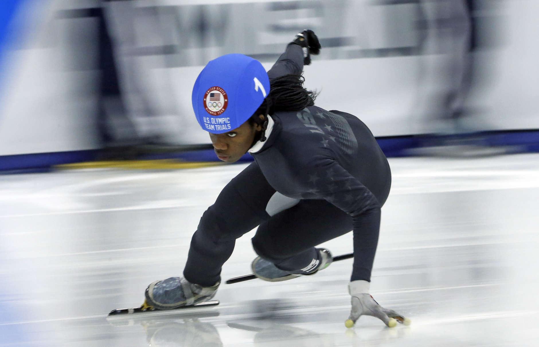 Maame Biney (1) competes in the women's 500-meter during the U.S. Olympic short track speedskating trials Saturday, Dec. 16, 2017, in Kearns, Utah. (AP Photo/Rick Bowmer)