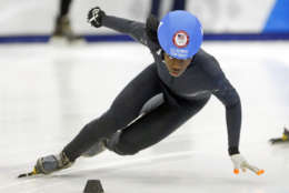 Maame Biney (1) competes in the women's 1000-meter during the U.S.Olympic short track speedskating trials Sunday, Dec. 17, 2017, in Kearns, Utah. (AP Photo/Rick Bowmer)