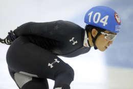 Thomas Insuk Hong (104) competes in the men's 1000-meter during the U.S.Olympic short track speedskating trials Sunday, Dec. 17, 2017, in Kearns, Utah. (AP Photo/Rick Bowmer)