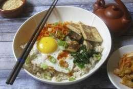 This Dec. 8, 2017 photo shows a Korean grain bowl in New York. This dish is from a recipe by Sara Moulton. (Sara Moulton via AP)