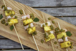 This Dec. 26, 2017 photo shows shrimp and pineapple skewers in Bethesda, Md. A super easy go-to recipe, which uses easy pantry ingredients, you can even use canned pineapple, to create something that still feels high-end. (Melissa daArabian via AP)