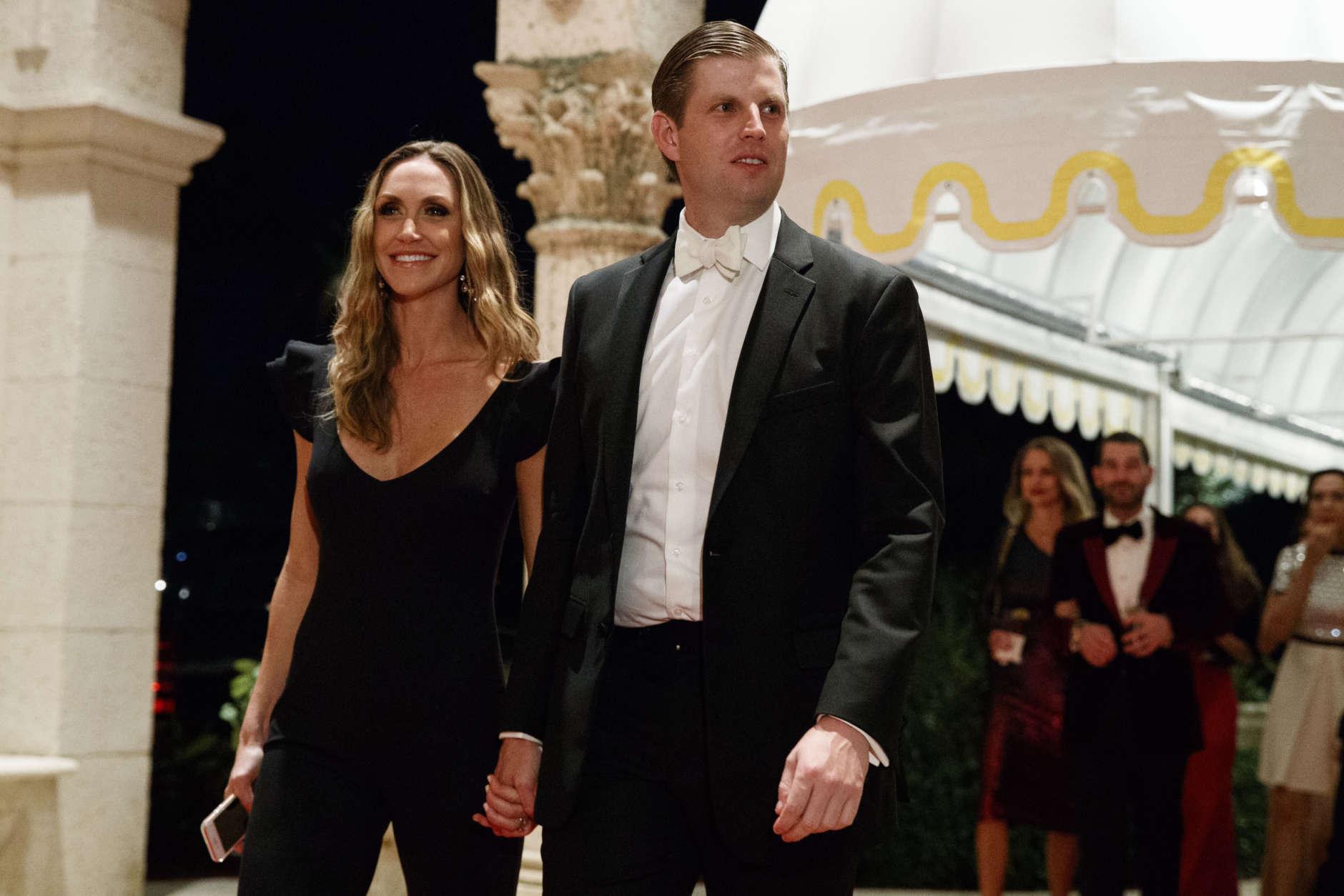 Eric Trump and his wife Lara Trump arrive for a New Year's Eve gala at Mar-a-Lago resort, Sunday, Dec. 31, 2017, in Palm Beach, Fla. (AP Photo/Evan Vucci)