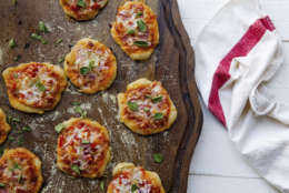 This Dec. 14, 2017 photo shows mini pizzas in New York. This dish is from a recipe by Katie Workman. (Carrie Crow via AP)