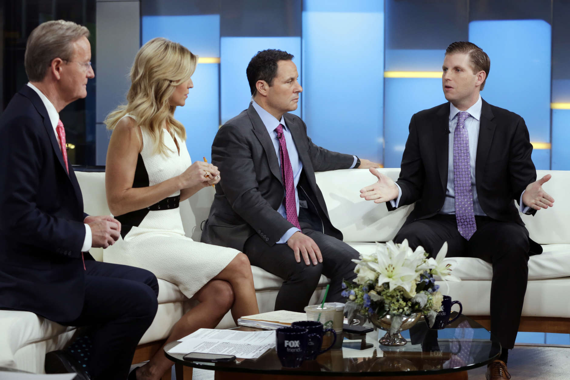 """Eric Trump, right, appears on the """"Fox & friends"""" television program, with co-hosts Steve Doocy, from left, Ainsley Earhardt and Brian Kilmeade, in New York Wednesday, Jan. 17, 2018. (AP Photo/Richard Drew)"""