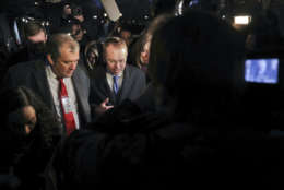 Director of the Office of Management and Budget Mick Mulvaney is surrounded by members of the media outside the White House, Friday, Jan. 19, 2018, and is questioned about a potential government shutdown this weekend. (AP Photo/Pablo Martinez Monsivais)