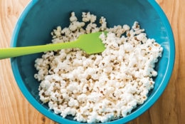 """This undated photo provided by America's Test Kitchen in January 2019 shows Real Buttered Popcorn in Brookline, Mass. This recipe appears in the cookbook """"Complete Cookbook for Young Chefs."""" (Joe Keller/America's Test Kitchen via AP)"""