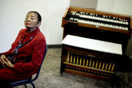 In this Wednesday, Nov. 14, 2012 photo, Christine King Farris, the sister to Rev. Martin Luther King Jr., and daughter of Martin Luther King Sr., sits next to the organ played by her mother, Alberta Christine Williams King, at which she was fatally shot while playing during a church service in 1974, as the organ sits on display in the new Martin Luther King, Sr. Community Resources Complex in Atlanta. The new Atlanta community center intended to help low-income residents become more financially secure has been envisioned as a living legacy for the Rev. Martin Luther King Sr., father of the civil rights icon. (AP Photo/David Goldman)