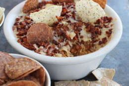 This Jan. 26, 2015 photo shows the New England super seven dip made with barbecued pulled pork topped with skillet sauteed apples and butter in Concord, N.H.  (AP Photo/Matthew Mead)