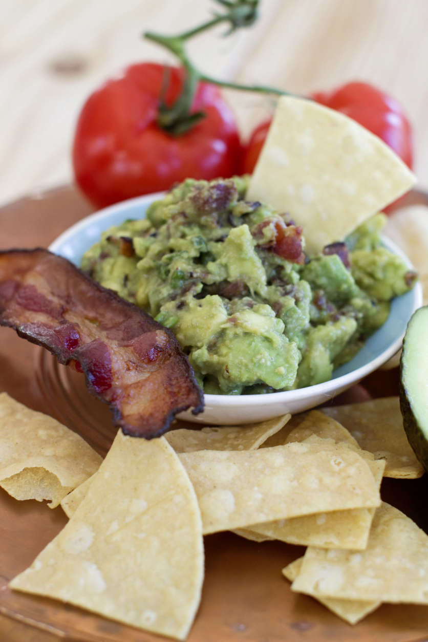 This Dec. 15, 2014 photo shows maple bacon guacamole in Concord, N.H. There are multiple ways to serve up guacamole for the Super Bowl. (AP Photo/Matthew Mead)