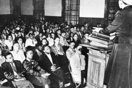 Martin Luther King, third from left, listens to a speaker during an assembly at Morehouse College, in Atlanta, GA, in 1948. King subsequently graduated from the college with a Bachelor of Arts degree in Sociology. (AP Photo)