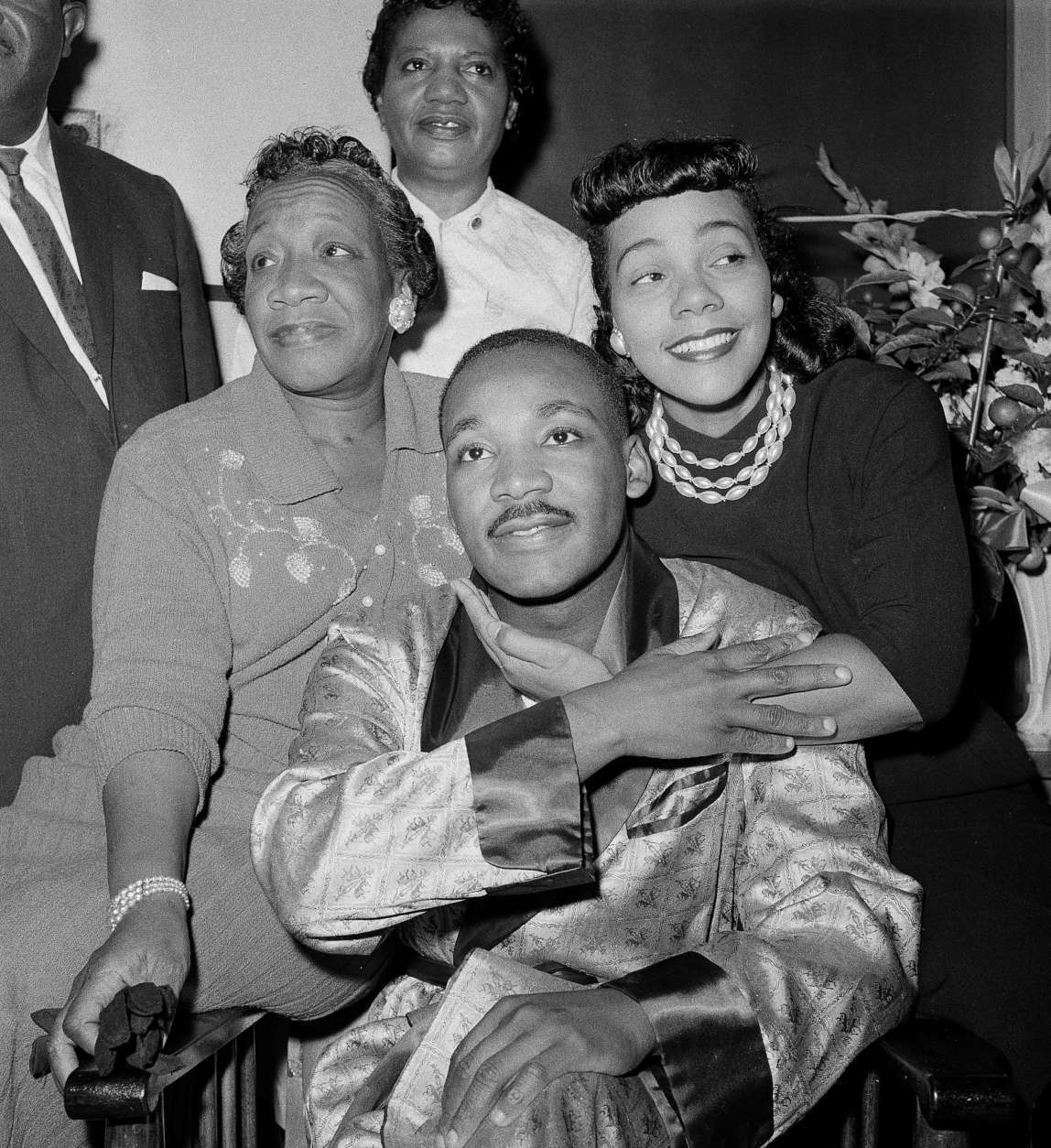 Dr. Martin Luther King, Jr., is embraced by his wife Coretta Scott King during a news conference at Harlem Hospital in New York, Sept 30, 1958, where he is recovering from a stab wound following an attack by a woman.  At left is his mother, Alberta Williams King.  (AP Photo/Tony Camerano)