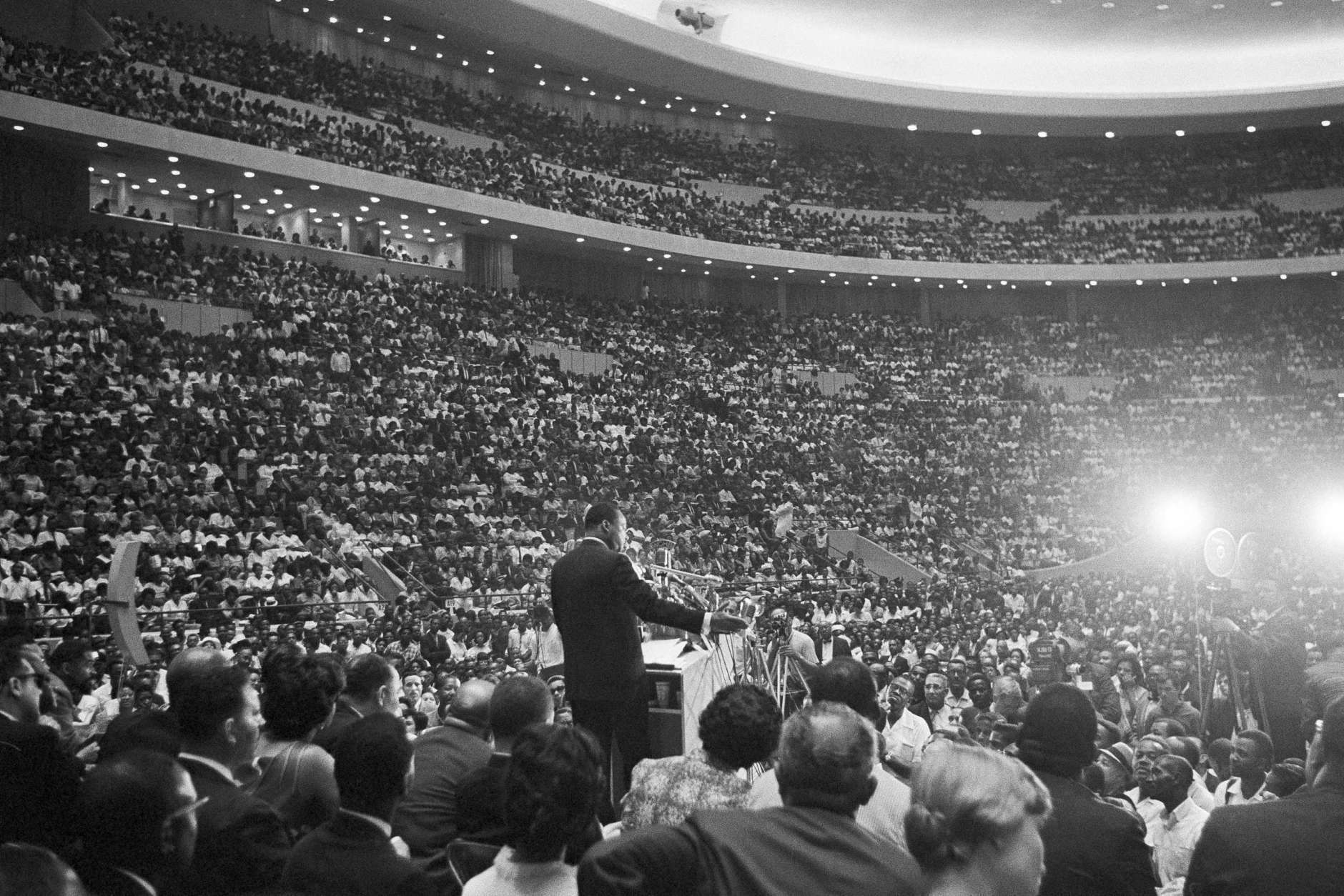 Rev. Martin Luther King Jr., speaks to an overflow crowd in Detroit?s Cobo Hall Arena on Sunday, June 24, 1963, following a ?Freedom March.?    An estimated 100,000 ?walkers? paraded to the hall through downtown Detroit and gathered in the hall and overflowed outside to hear him speak on the rights of Blacks.  (AP Photo)