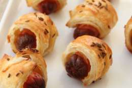 This Jan. 11, 2016 photo shows a puff pastry pig in a blanket topped with caraway seeds in Concord, N.H. This is from a recipe by Sara Moulton. (AP Photo/Matthew Mead)