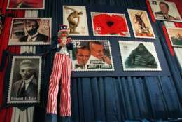 A stilted Uncle Sam, portrayed by Brian McNelis, stands in front of blow ups of proposed 1996 U.S. Postage Stamps during a news conference at the U.S. Postal Museum in Washington Tuesday Nov. 7, 1995 where the new designs were announced. (AP Photo/Charles Tasnadi)