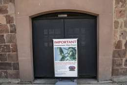 "An advertisement for a cruise around the Statue of Liberty and Ellis Island is placed at the entrance to Castle Clinton, Saturday, Jan. 20, 2018, in New York. The National Park Service announced that the Statue of Liberty and Ellis Island would be closed Saturday ""due to a lapse in appropriations."" Late Friday, the Senate failed to approve legislation to keep the government from shutting down after the midnight deadline. (AP Photo/Mary Altaffer)"