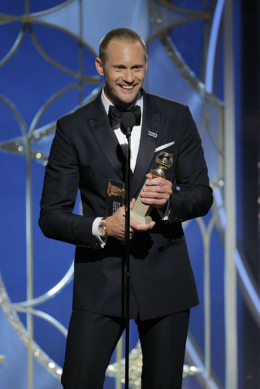 "CORRECTS SPELLING OF SKARSGARD - This image released by NBC shows Alexander Skarsgard accepting the award for best performance by a supporting actor in a series, limited series of film made for TV for his role in ""Big Little Lies,"" at the 75th Annual Golden Globe Awards in Beverly Hills, Calif., on Sunday, Jan. 7, 2018. (Paul Drinkwater/NBC via AP)"
