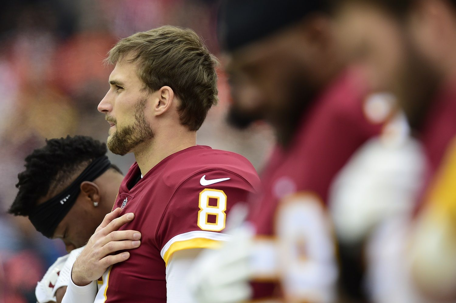 LANDOVER, MD - DECEMBER 24: Quarterback Kirk Cousins #8 of the Washington Redskins listens to the National Anthem before a game against the Denver Broncos at FedExField on December 24, 2017 in Landover, Maryland. (Photo by Patrick McDermott/Getty Images)