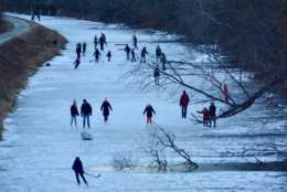 Droves of people young and old carve into the frozen surface of the C&O Canal on Tuesday, January 2, 2018. For many families, ice skating in the National Park is a tradition that goes back generations.  (WTOP/Dave Dildine)